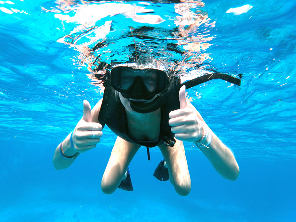 beach cleaning and snorkel activities in jamaica - snorkel girl