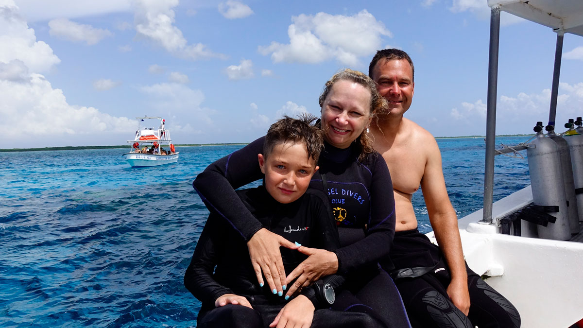family diving in the caribbean - on the boat